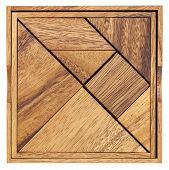 stock photo of parallelogram  - Pieces of a traditional Chinese Puzzle Game made of different wood parts to build abstract figures from them - JPG