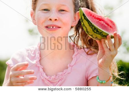 Little Girl And Her Watermelon