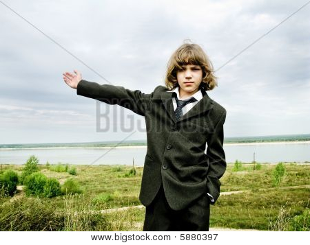 Young boy with raised hand