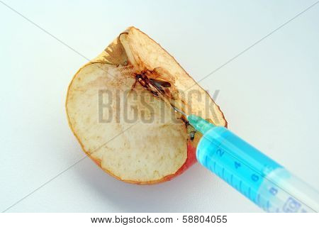 Apple and syringe