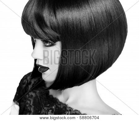 Lady Vamp Style. Brunette Woman Close-up Portrait.  Black Short Hair Style. Black And White Photo.