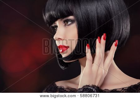 Brunette Woman Portrait. Black Short Hair Style. Manicured Nails And Red Lips. Fashion Beauty Photo