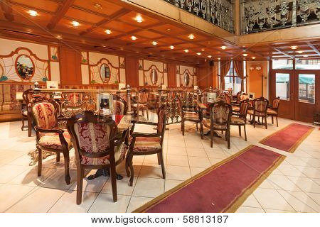 SARAJEVO, BOSNIA AND HERZEGOVINA - AUGUST 13, 2012: Empty interior of the famous Wiener cafe, located in the centre of old town Sarajevo.