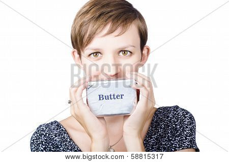 Young Woman Holding A Block Of Butter