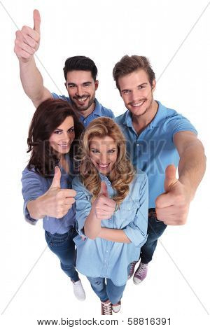 wide angle picture of group of casual people smiling and making the ok thumbs up hand sign  on white background