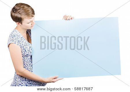 Young Saleslady Holding A Blank White Sign