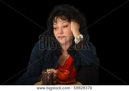 Bored Mature Woman Drinks Coffee
