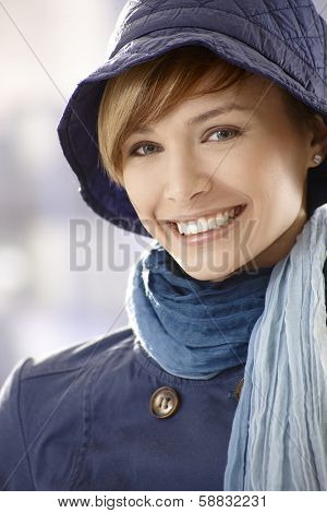 Closeup portrait of happy young woman early spring clothing