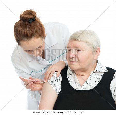Doctor Making Senior Woman Patient An Arm Subcutaneous Insulin
