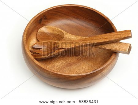 Wooden salad serving bowl with utensils.