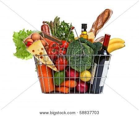 Metal shopping basket with groceries