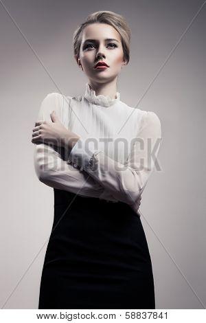 Beautiful Blonde Woman. Retro Fashion Image.
