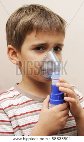 Young boy inhales