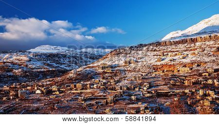 Beautiful landscape of mountainous town in winter, many cozy cottage, eco tourism, Faraya mountain in Lebanon, ski resort, wintertime holidays concept
