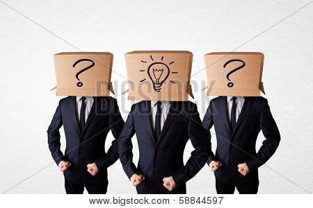 Group of handsome people gesturing with sketched lighbulbs and question mark on box
