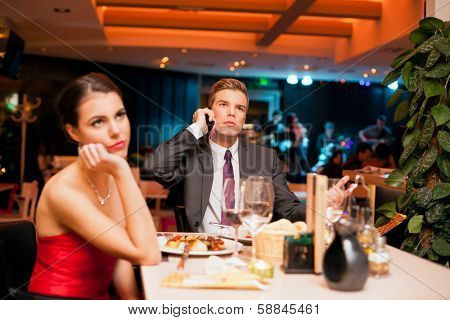 Young man making an boring  expression gesture on a bad dating