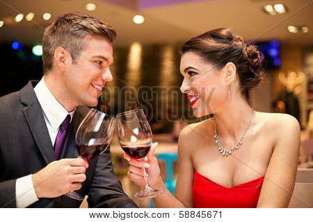 Love couple looking each other and toasting