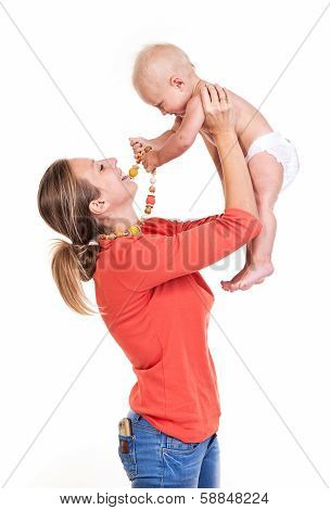Young Caucasian woman lifting her baby son