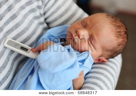 Father and newborn son with thermometer