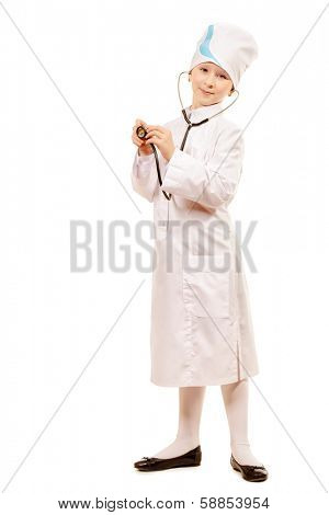 Pretty ten years girl dressed like a doctor smiling at camera. Isolated over white.