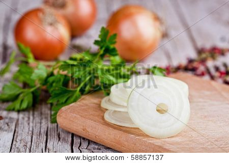 fresh onions and parsley on  wooden bord