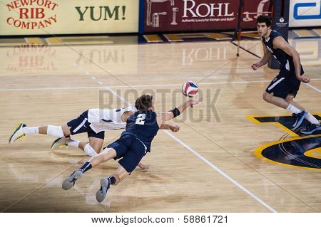 IRVINE, CA - JANUARY 17: Brigham Young's Carson Heninger dives for the dig in a volleyball match with the University of California - Irvine at the Bren Events Center in Irvine, CA on January 17, 2014