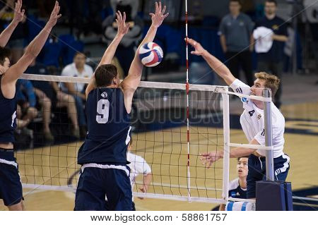 IRVINE, CA - JANUARY 17: Travis Woloson of UCI spikes the ball in a volleyball match with Brigham Young University at the Bren Events Center in Irvine, CA on January 17, 2014