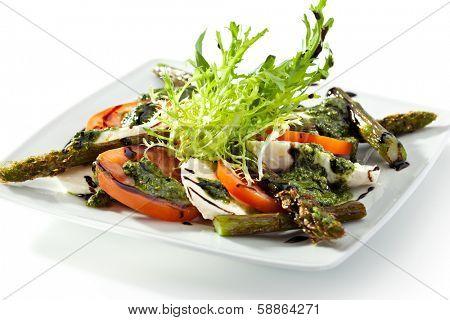 Caprese Salad - Salad with Tomatoes, Mozzarella Cheese, Asparagus, Balsamic. Salad Dressing with Pesto Sauce