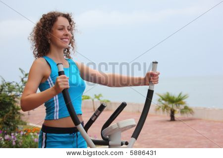 Smiling Girl On Training Apparatus Outdoor