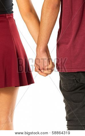 Back view of young couple of sweethearts holding hands over white background