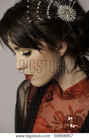 Portrait of beautiful brunette woman with hair clip