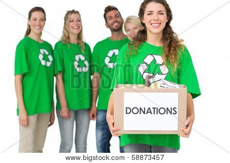 Group portrait of young people in recycling symbol t-shirts with donation box over white background