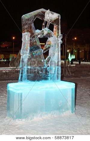 Perm, Russia - Jan 11, 2014: Illuminated Figure Skater Sculpture In Ice Town At Evening, Created In