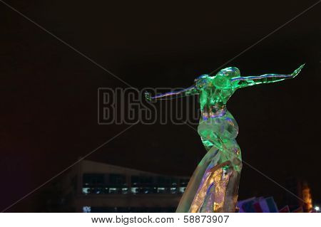 Perm, Russia - Jan 11, 2014: Sculpture Woman In Ice Town At Evening. Construction Of Ice Town Of Per