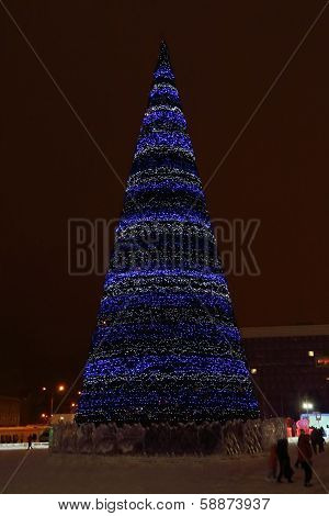 Perm, Russia - Jan 11, 2014: Christmas Tree In Ice Town At Evening. Construction Of Ice Town Of Perm