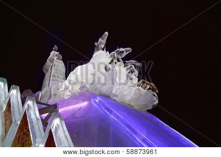 Perm, Russia - Jan 11, 2014: Horse Triple And Santa Sculpture In Ice Town At Evening. Construction O