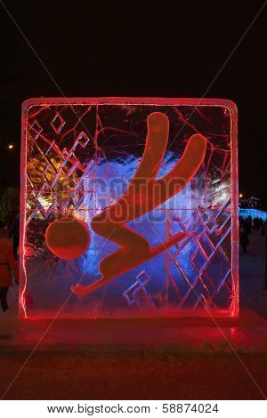 Perm, Russia - Jan 11, 2014: Illuminated Red Toboggan Character Sculpture In Ice Town At Evening, Cr