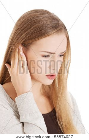 Beautiful casual woman is touching her ear. Health concept. Isolated on white.