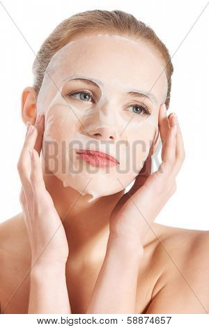 Beautiful young woman with collagen mask. Isolated on white.