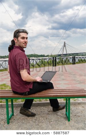 Guy With Laptop In The Park