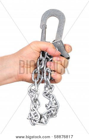 Hand holds carbine on chain.