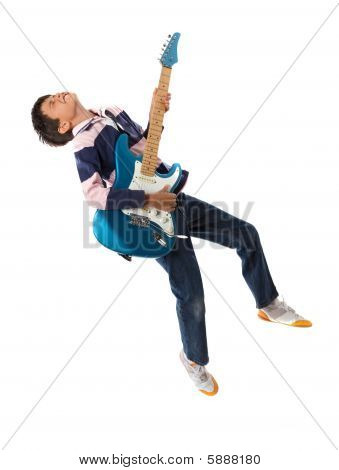 Child Jumping With A Guitar