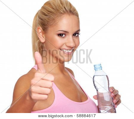 Attractive Young Woman Holding Bottle Of Water And Holding Thumbs Up