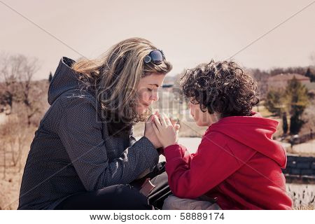 Small Family Praying Outdoors