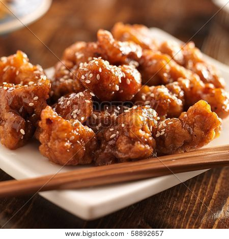 chinese sesame chicken with chopsticks