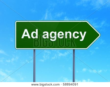 Advertising concept: Ad Agency on road sign background