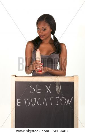 Afro-american Woman With Vibrator By Blackboard