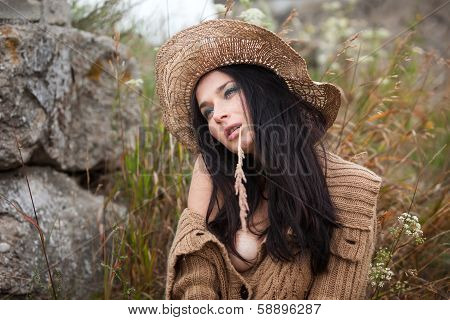 Girl Against Background Of Nature And Old Stones