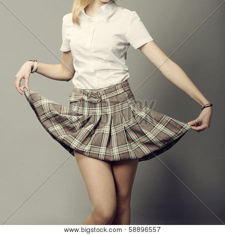 Young Lady Lifting Up Her Short Plaid Skirt