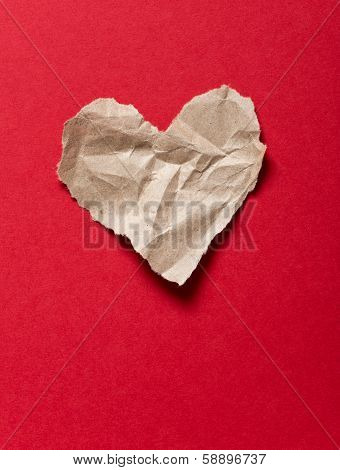 Torn Paper Heart On A Red Background
